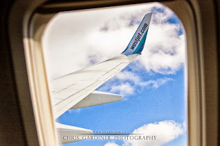 Airplane window seat photography by Chris Gardiner www.cgardiner.ca who tends to fly westjet a lot
