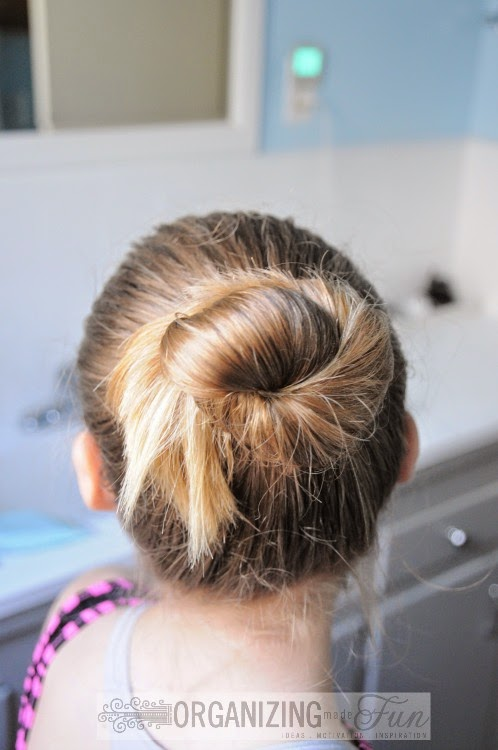 Beautiful, simple girls' bun using a Goody hairbrush and hairspray :: OrganizingMadeFun.com