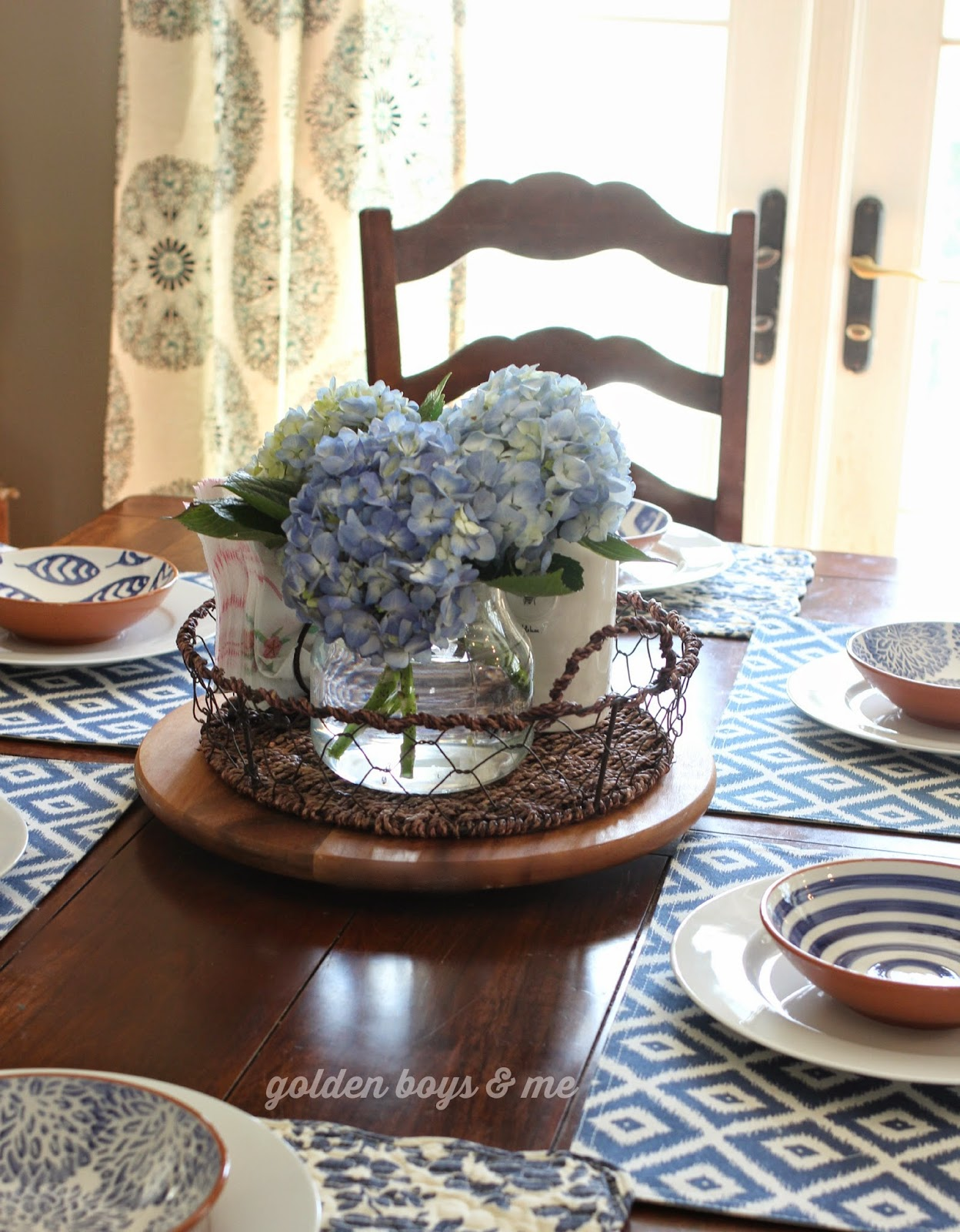 Blue hydrangea centerpiece in blue and white table setting - www.goldenboysandme.com