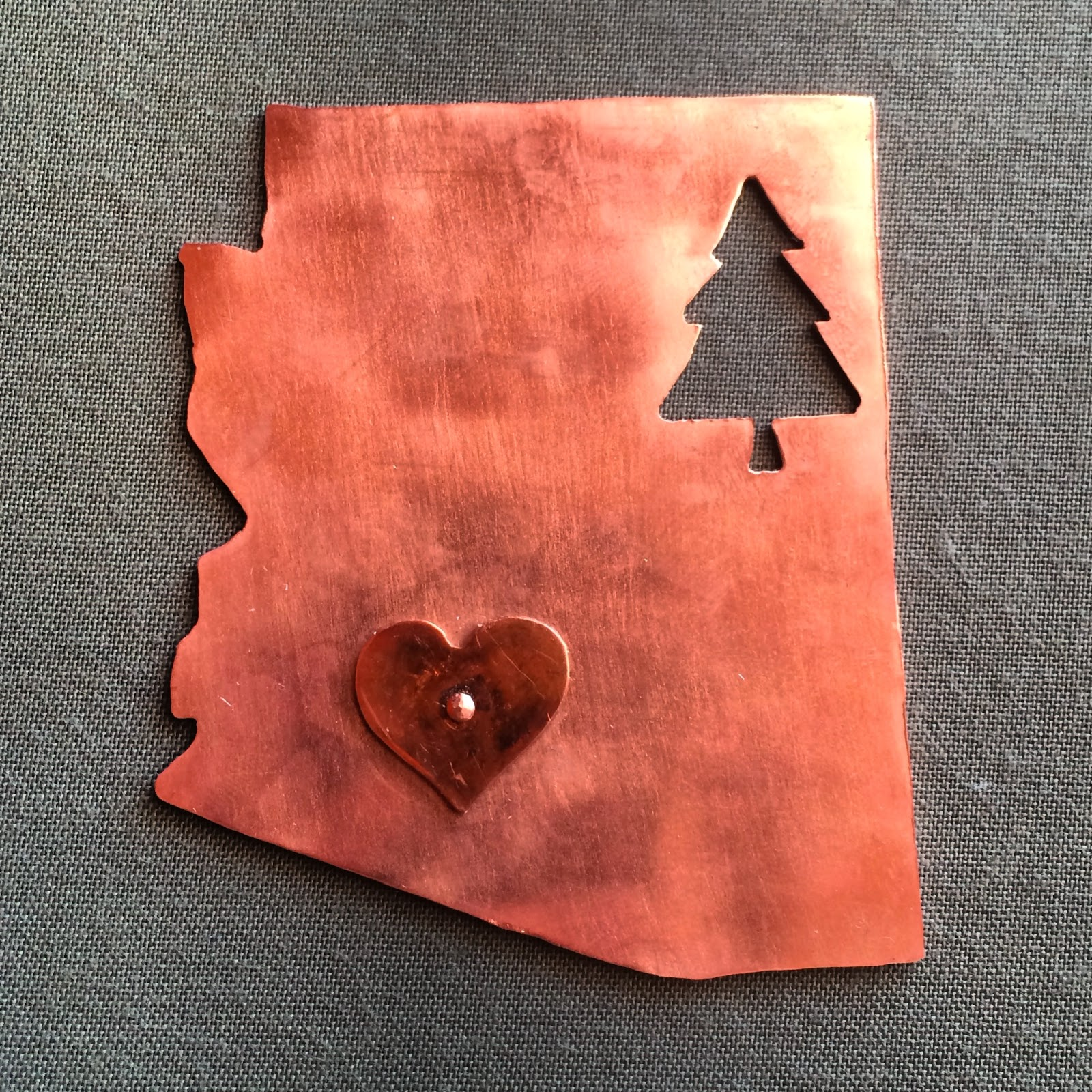 Handmade arizona state copper magnet with a pine tree cutout and heart riveted to the top