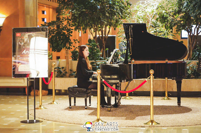 Live piano music right when we arrive Ramada Plaza Jeju Ocean Front