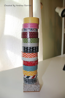 "Washi tape holder made with a dowel glued to a 2"" square piece of granite."