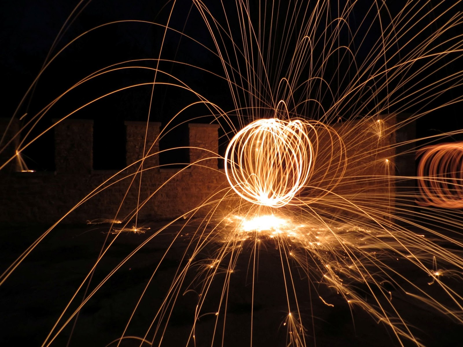 http://www.boostyourphotography.com/2013/04/spinning-fire-with-steel-wool.html
