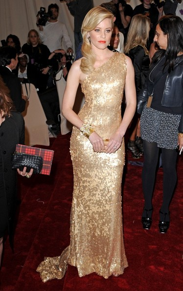 Elizabeth Banks glowed on the red carpet at the 2011 Met Gala, in a dazzling gold-sequined one-shoulder gown by Tommy Hilfiger.