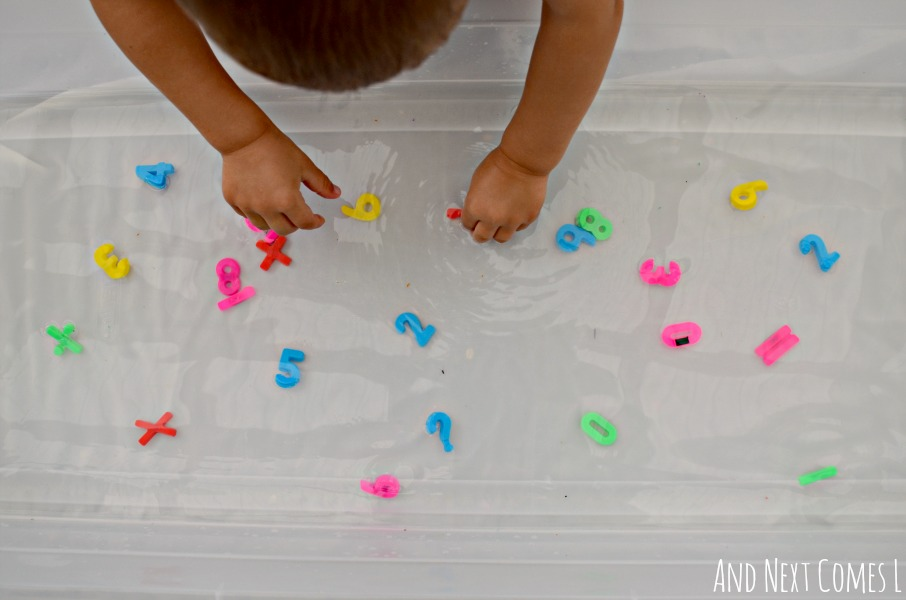 Early math water sensory play for kids using number magnets from And Next Comes L