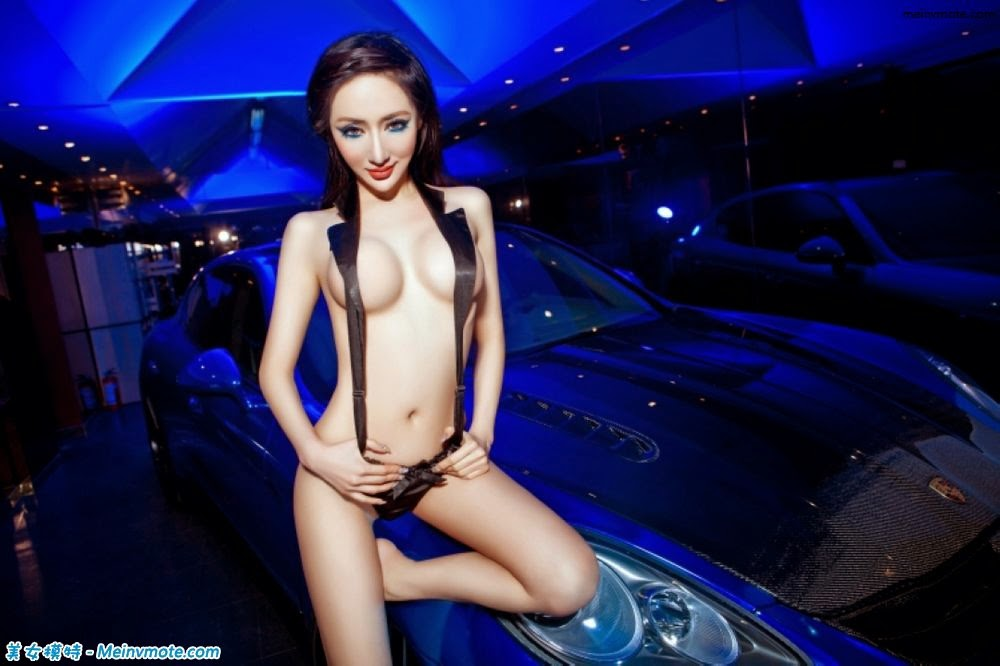 Unrestrained nearly naked young model luxury car experience