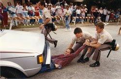 Clinic protester blocks car