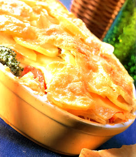 Classic layered fish pie in a baking dish, the traditional fare for Good Friday
