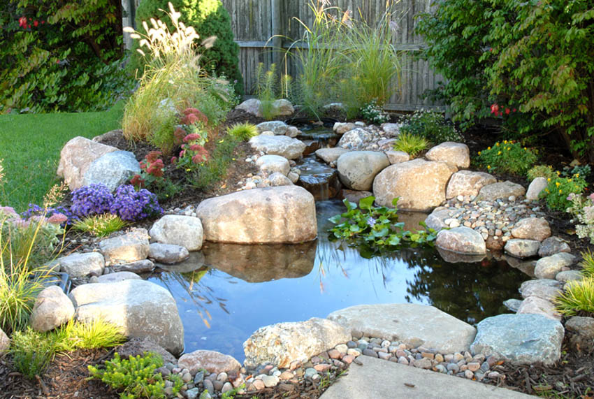 the waterfall is in proportion to this smaller pond nestled snug