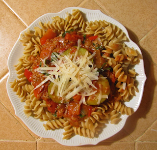 Plate of Rigatoni Topped with Sauce and Grated Parmesan
