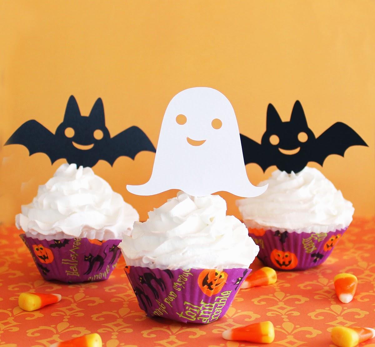http://www.tiffzippy.com/halloween-cupcake-toppers/