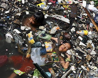 Yamuna River filled with garbage and a little boy swimming