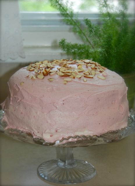 A garden party needs a yummy cake: Almond cake topped layered with fresh whipped cream and the most scrumptious strawberry icing!! 