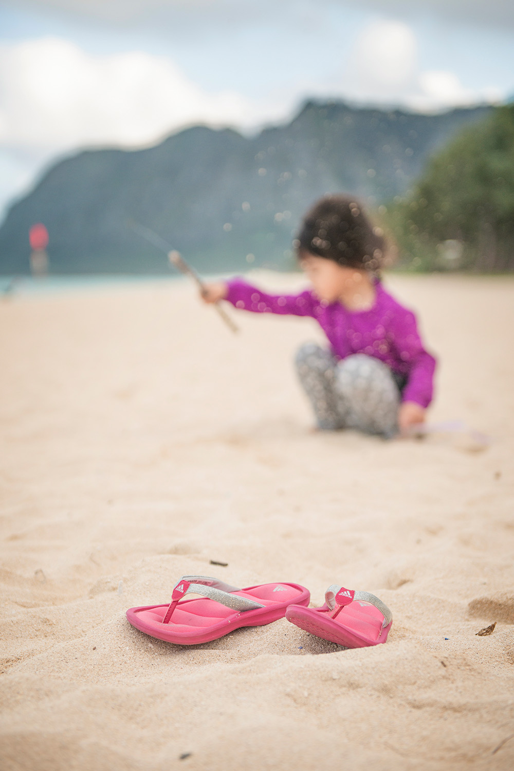 Andrea playing sand, slippers