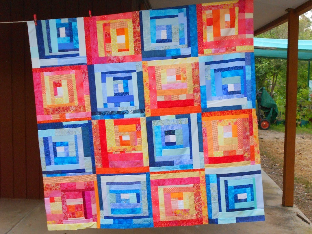 perspective quilts how she modern patch visits pattern dora random thread quilting studios with contrasting cary dot doras the quilt nine fresh favorites is orange loves blue of nickel her enhances one