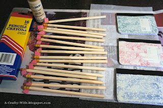 Paint pencils and notebook covers with craft paint to prevent bleed through with washi tape | A Crafty Wife