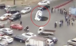 Driver escapes as sinkhole swallows car in China