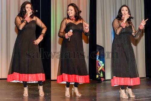 Singer in High Neck Salwar