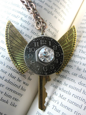 Steampunk style winged key necklace