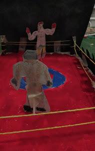 Genial! un ring con boxeadores y público!