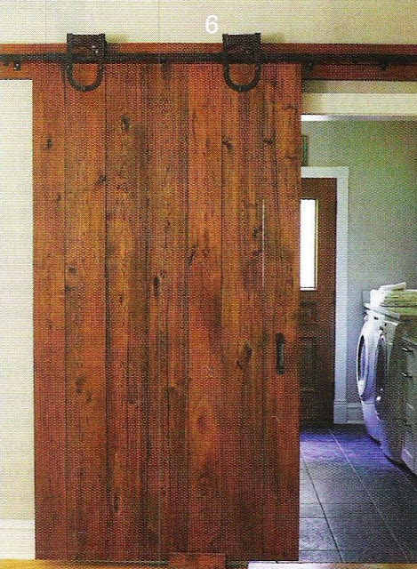 sliding barn-style door to the laundry took up less space than a ...