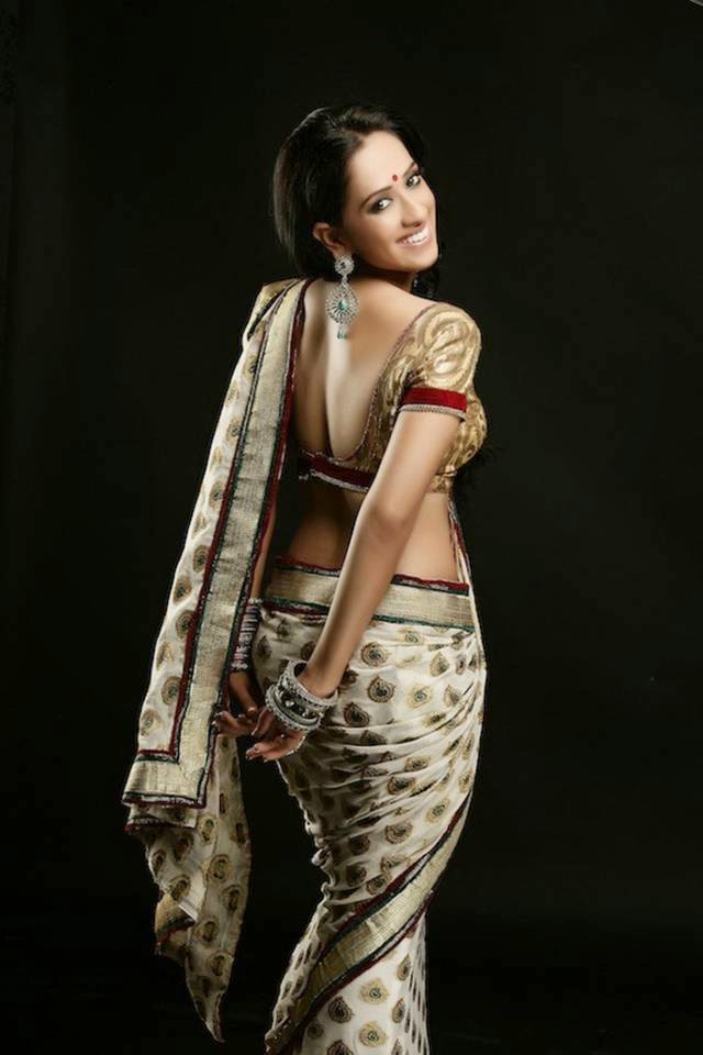 The Indian Saree and Monali Sehgal — Every county have its own traditional dress. Now days women specially wears jeans, skirts, shorts, tops shirt, sando banyans and t-shirts, but I think Indian traditional dresses much better then all these western dress. I am not criticizing, but i love to see women in Indian dress. Indian women can easily identify with their clothing's, Specially saree and salwar kameez. Today I post the saree photo-shoot of south Indian actress and model of Monali Sehgal. She look stunning.