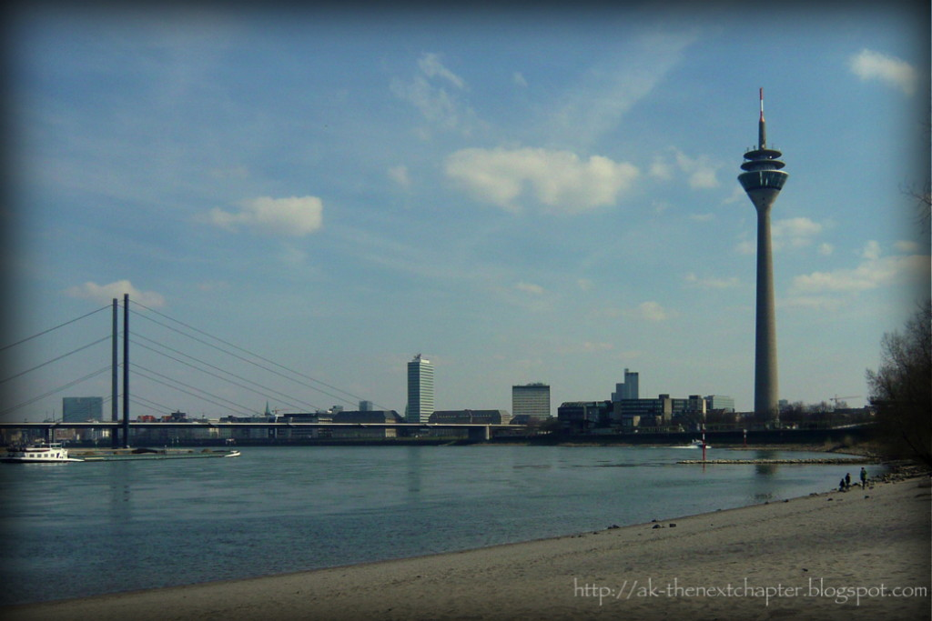 River, sandbank and a bridge in the background, Düsseldorf TV-tower to the right