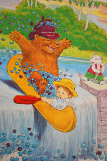Boy and bear in boat with blueberries, Jamberry by Bruce Degen