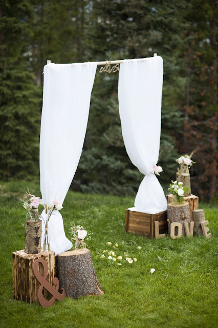 rustic outdoor wedding arch
