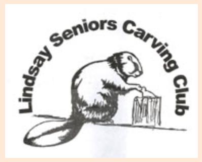 image Lindsay Ontario Seniors Carving Club  Beaver chopping wood