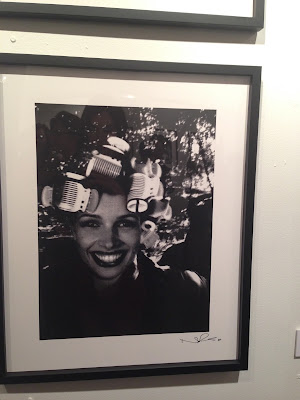 Norman Reedus photography exhibition in Los Angeles. Girl in curlers.