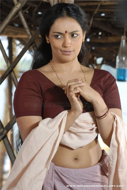 Naughty smile Shwetha Menon with only blouse