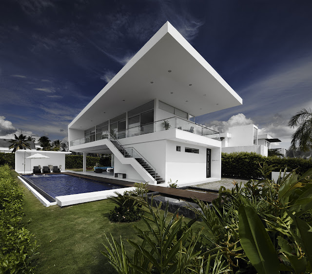 Modern home with swimming pool as seen from the backyard