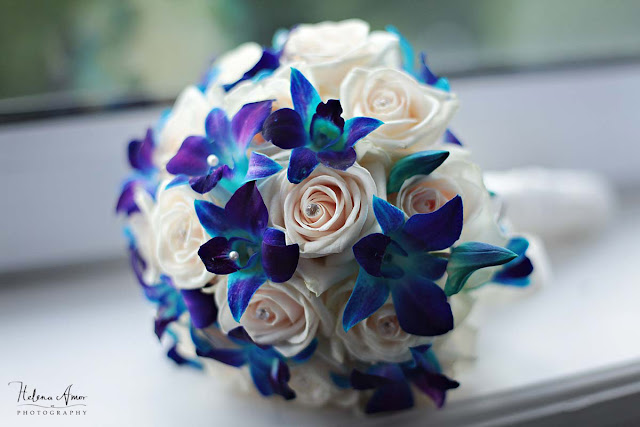 cream roses and blue flowers bridal bouquet