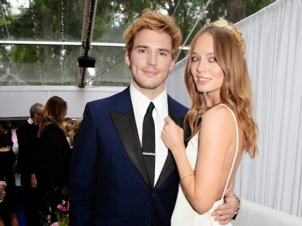 Laura Haddock and Sam Claflin in Alexander McQueen navy tuxedo at 2014 Glamour Women of the Year Awards