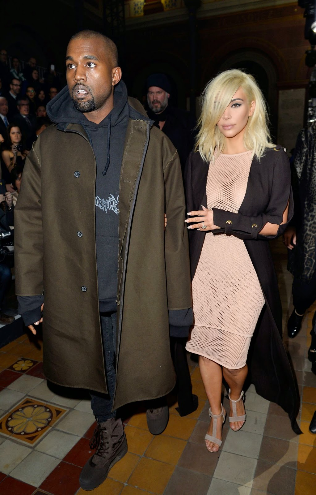 Kim Kardashian goes braless in a sheer mesh dress at the Lanvin Paris Fashion Week Show