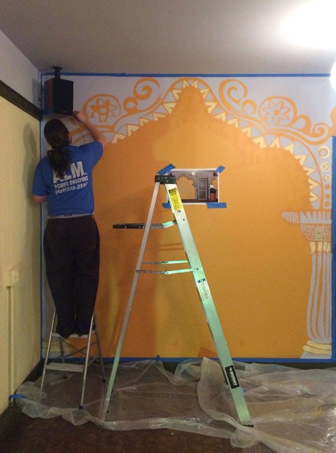 yoga studio mural at yogawood the process from sketches to painting
