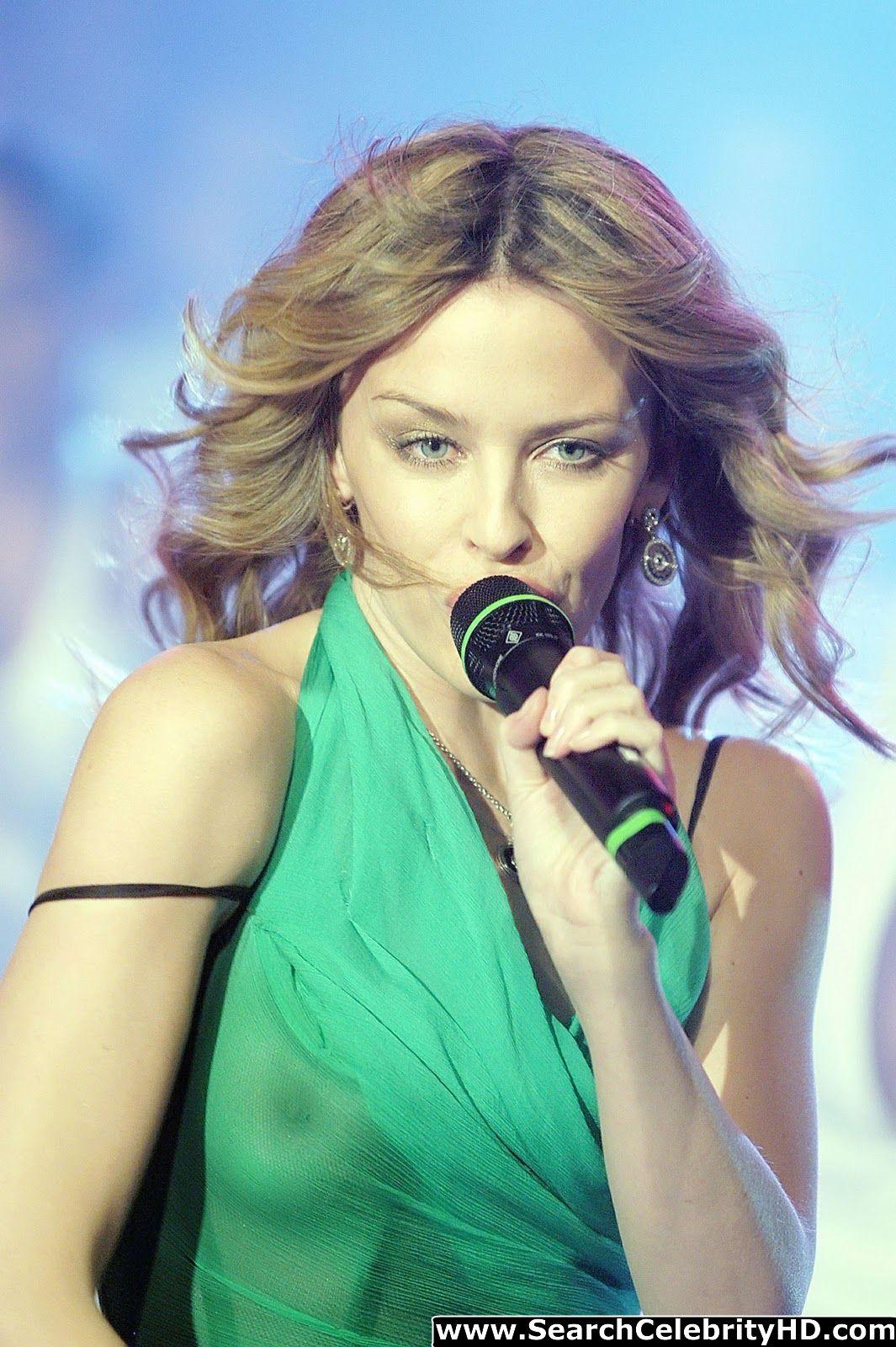 http://3.bp.blogspot.com/-vT-AN-165qc/UMxWb5Qc6wI/AAAAAAAAAGk/6orwyTfmtwo/s1600/Kylie+Minogue+See-Through+Boobie+Revealing+Green+Top-www.searchcelebrityhd.com-001+(1).jpg