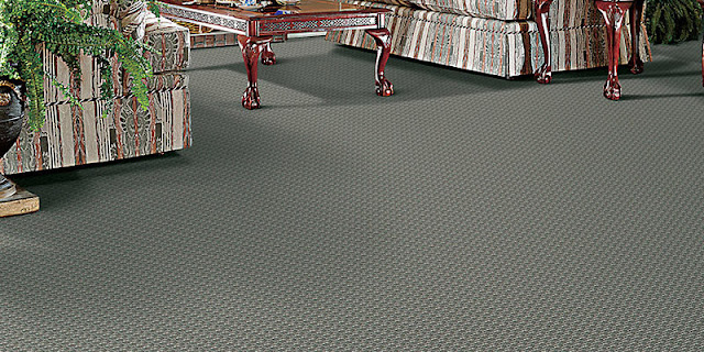 Bold patterned carpet in family room (small green pattern with texture)