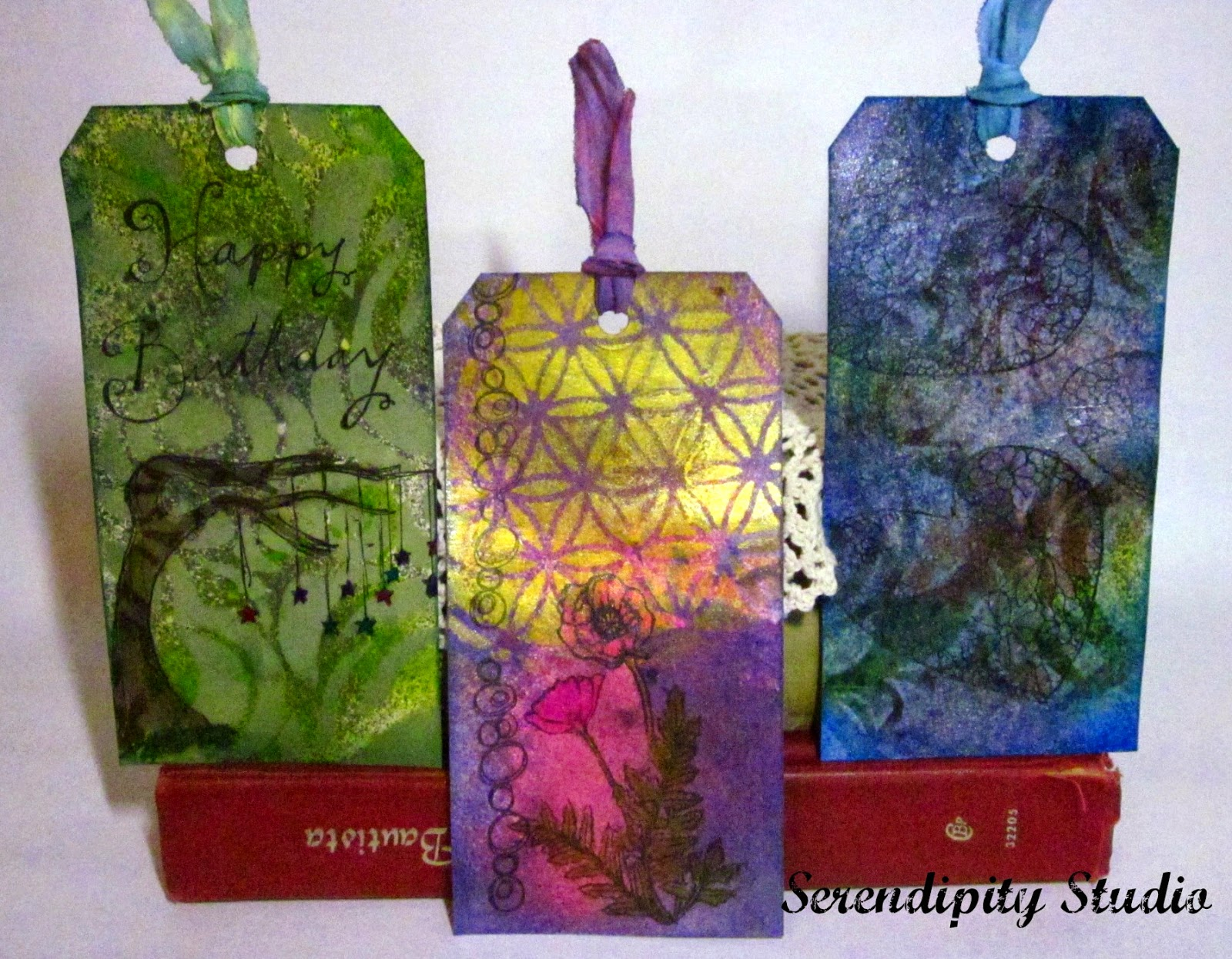 RubberMoon Stamps on shimmery tags, created by www.serendipitystudiobycw.blogspot.ocm