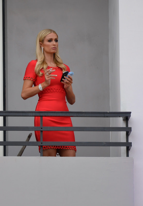 Paris Hilton in orange dress at her Hotel in Cannes