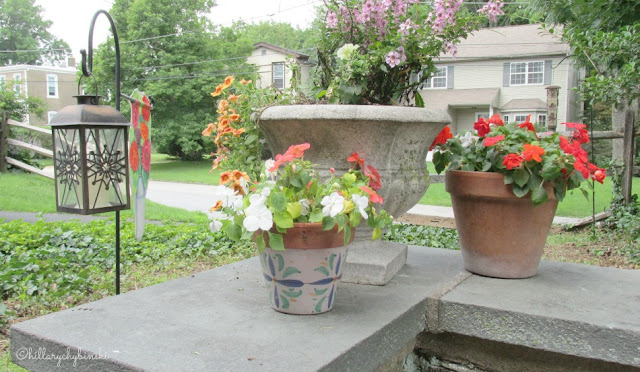 Add some easy plants and flowers in small, inexpensive pots for pops of color and to soften sapces