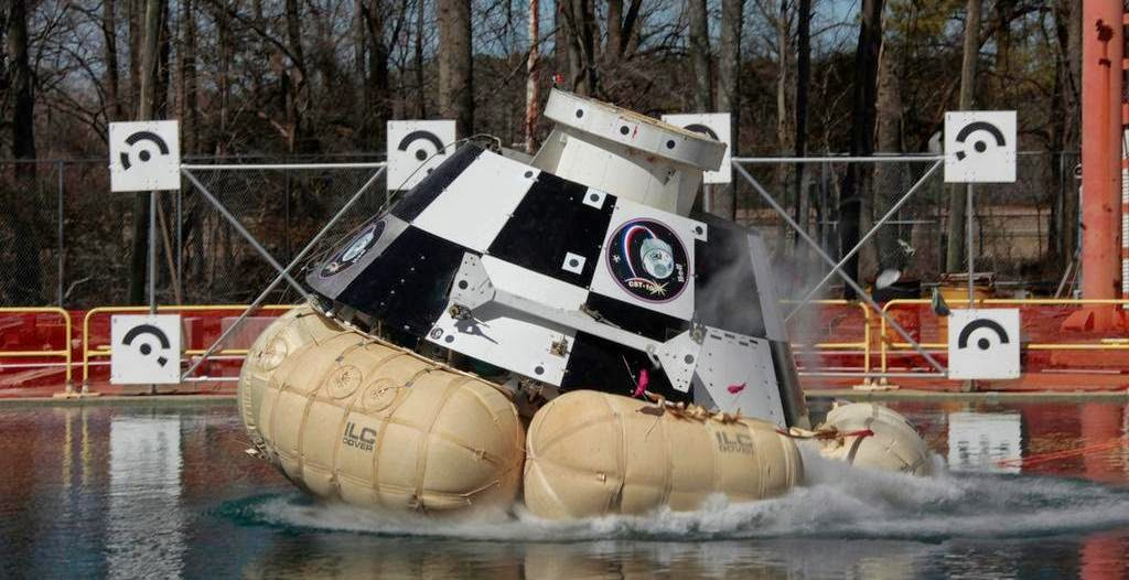 Boeing's CST100 capsule makes a big splash on Apr. 9 at NASA Langley's hydro impact basin, testing abort scenarios. Credit: NASA/Boeing