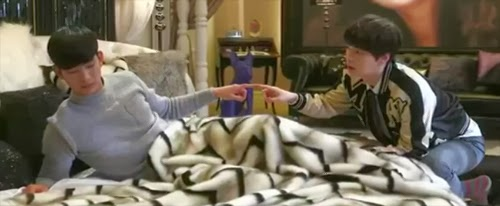 Do Min Joon and Chun Yoon Jae touch fingertips in Song Yi's bedroom.