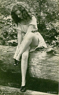 Vintage girl sitting in woods
