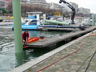 Workers taking away our old pontoons