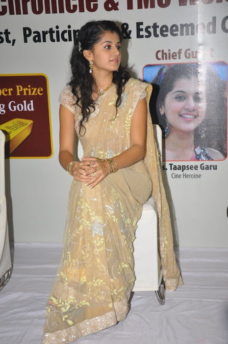 tapsee in saree at tmc electronics latest photos