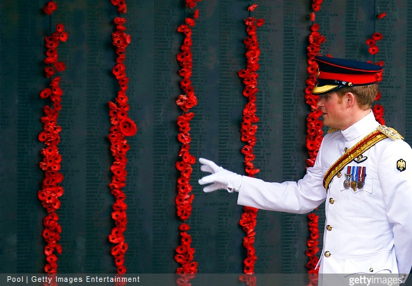 Prince Harry walks along the Roll of Honour with officials during a visit to the Australian War Memorial on April 6, 2015 in Canberra, Australia