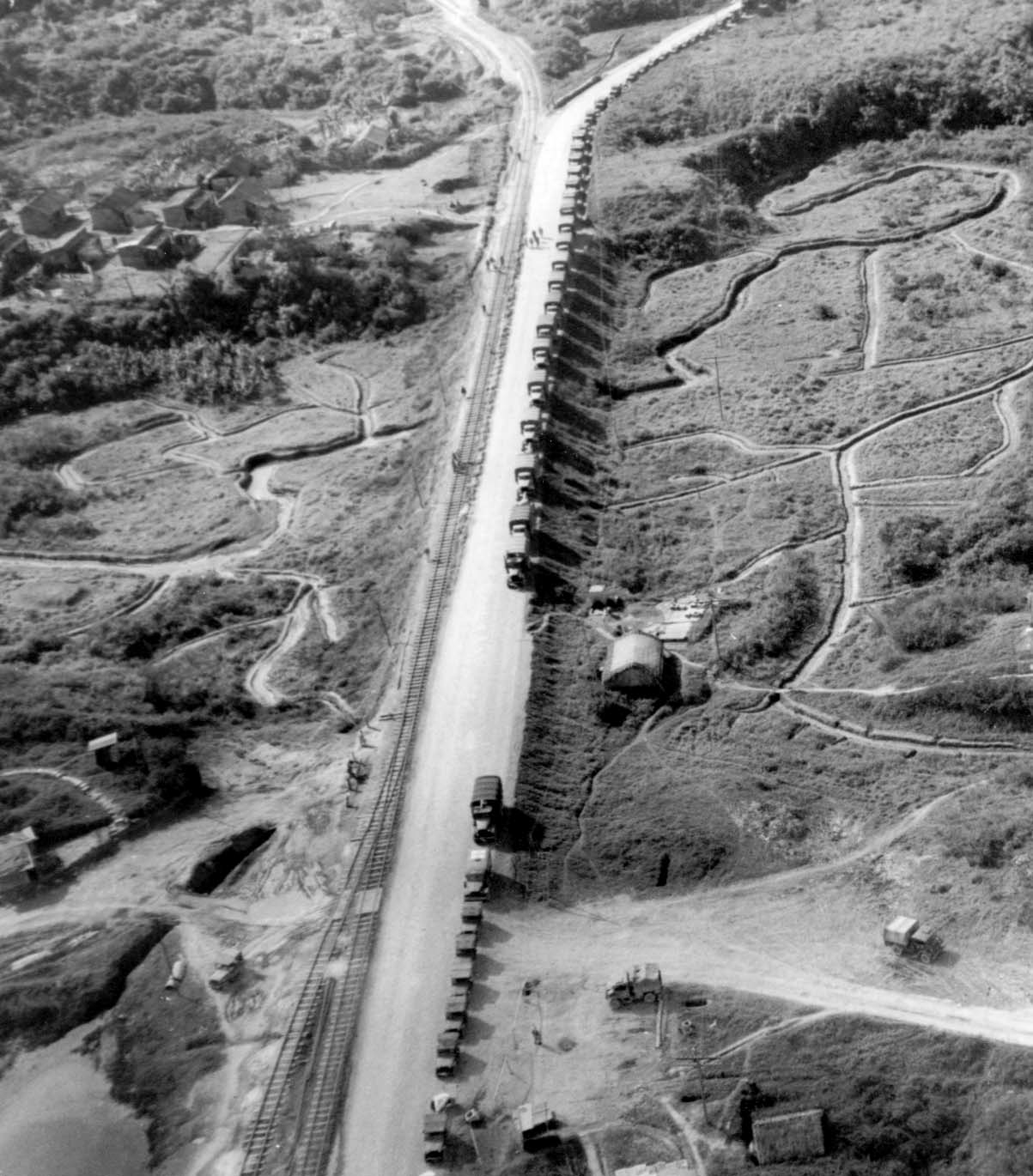 The first China truck convoy zigzags down the Stillwell ROad in to the Mi-tu Val