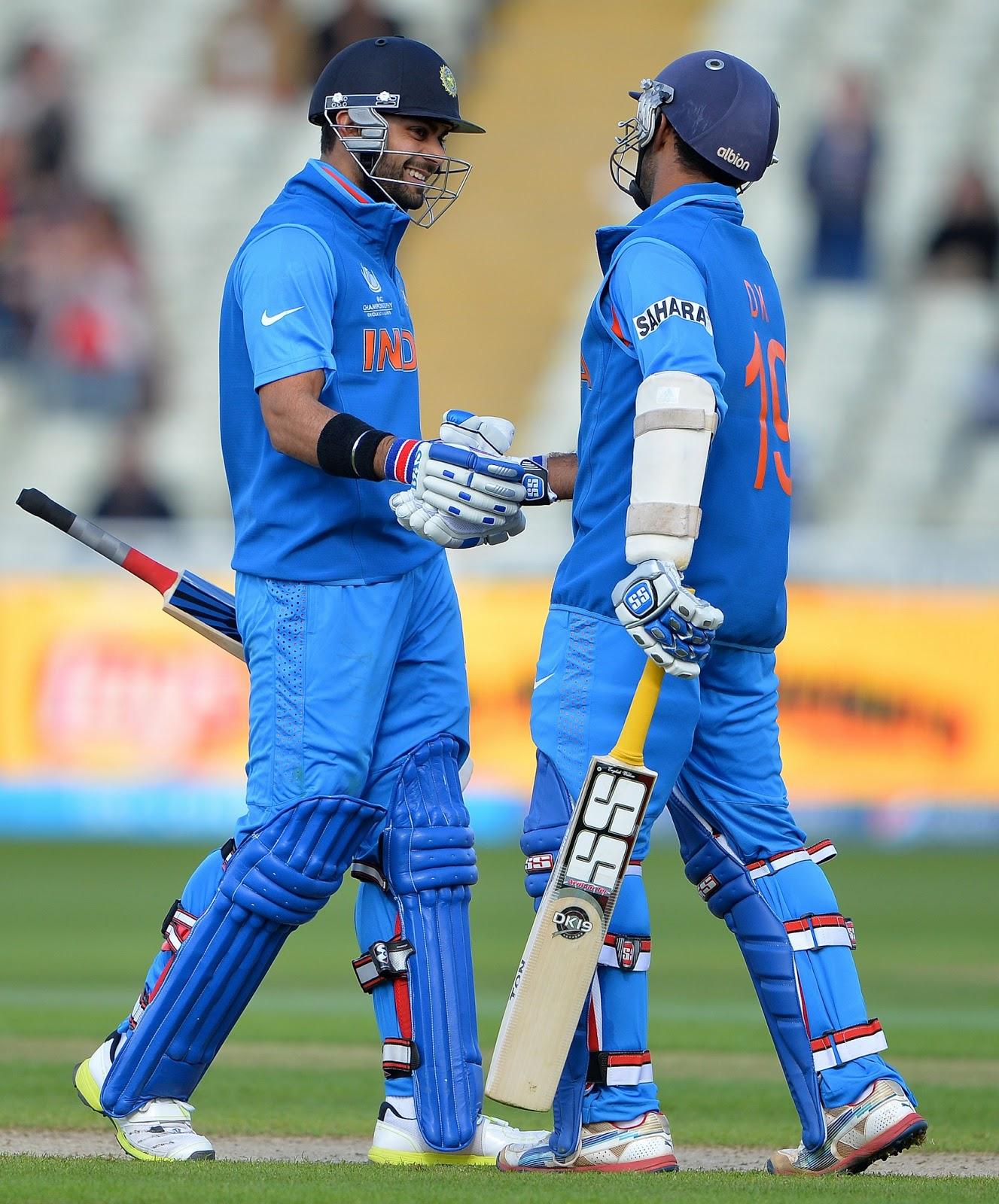 Virat-Kohli-Dinesh-Karthik-champions-trophy-2013-Warm-Up-vs-Srilanka